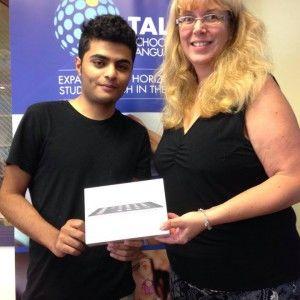 TALK English school director with graduate